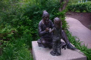 Sculpture of Grandfather Telling Story to Grandaughter