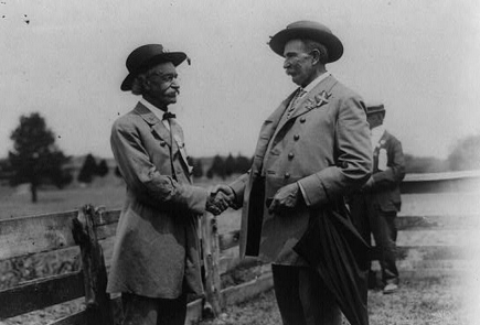 Celebration at Bull Run: 2 Confederate veterans shaking hands